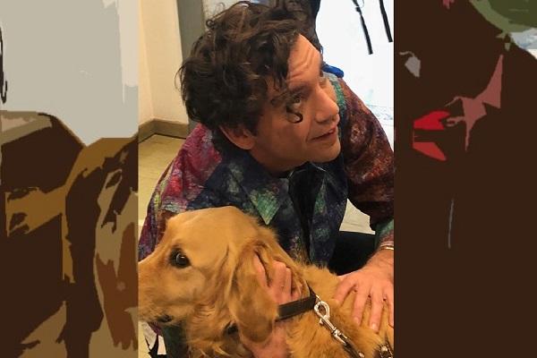 Italo e il cantautore Mika. Mika è inginocchiato e abbraccia Italo per fargli le coccole